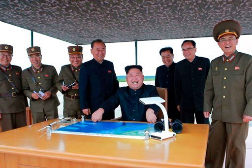 (Korean Central News Agency/Korea News Service via AP, File). This Aug. 29, 2017, file photo distributed on Wednesday, Aug. 30, 2017, by the North Korean government, North Korean leader Kim Jong Un, center, smiles as Kim inspects the test launch.