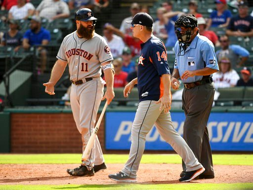 (AP Photo/Jeffrey McWhorter). Houston Astros manager AJ Hinch (14) goes out to argue that Texas Rangers relief pitcher Keone Kela balked as Astros' Evan Gattis (11) turns to talk to home plate umpire Alfonso Marquez, right, during the ninth inning of a...