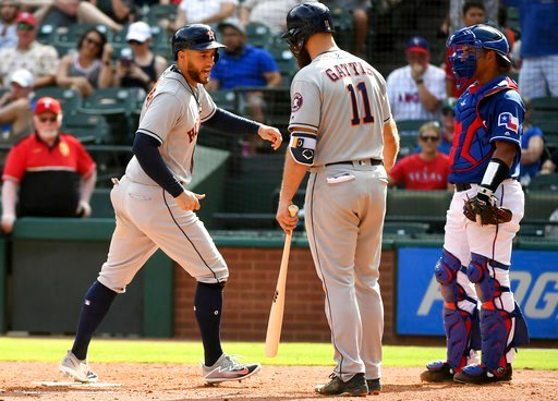 (AP Photo/Jeffrey McWhorter). Houston Astros' George Springer, left, scores on a balk by Texas Rangers relief pitcher Keone Kela as Houston Astros' Evan Gattis (11) and Texas Rangers catcher Carlos Perez look on during the ninth inning of a baseball ga...