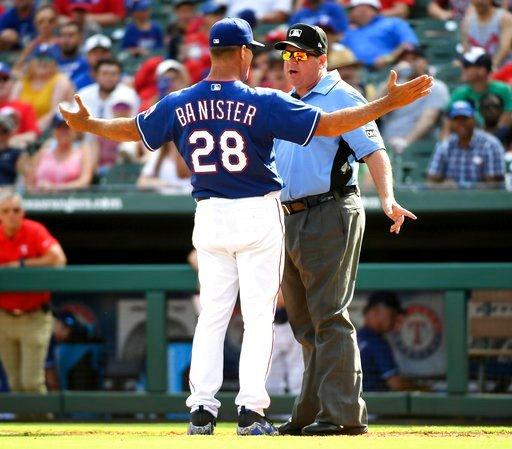 (AP Photo/Jeffrey McWhorter). Texas Rangers manager Jeff Banister (28) argues with third base umpire Sam Holbrook after Rangers relief pitcher Keone Kela was called for a balk which gave the Houston Astros the winning run during the ninth inning of a b...