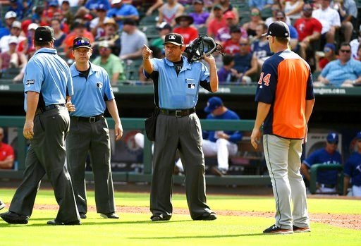 (AP Photo/Jeffrey McWhorter). Home plate umpire Alfonso Marquez, center, signals for Houston Astros' George Springer to score after calling a balk on Texas Rangers relief pitcher Keone Kela as Astros manager AJ Hinch looks on during the ninth inning of...