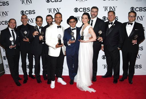 """(Photo by Evan Agostini/Invision/AP). Cast and crew of """"The Band's Visit"""" pose in the press room with the award for best musical at the 72nd annual Tony Awards at Radio City Music Hall on Sunday, June 10, 2018, in New York."""