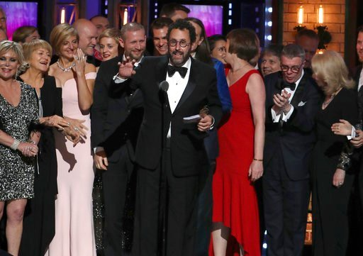 """(Photo by Michael Zorn/Invision/AP). Playwright Tony Kushner, center, and the cast and crew of """"Angels in America"""" accept the award for best revival of a play at the 72nd annual Tony Awards at Radio City Music Hall on Sunday, June 10, 2018, in New York."""