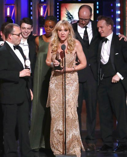 """(Photo by Michael Zorn/Invision/AP). Producer Sonia Friedman and the cast and crew of """"Harry Potter and the Cursed Child, Parts One and Two"""" accept the award for best play at the 72nd annual Tony Awards at Radio City Music Hall on Sunday, June 10, 2018..."""