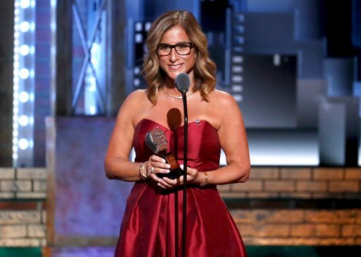 (Photo by Michael Zorn/Invision/AP). CORRECTS NAME OF SCHOOL TO MARJORY FROM MARJORIE - Melody Herzfeld, drama teacher at Marjory Stoneman Douglas High School, accepts the award for excellence in theatre education at the 72nd annual Tony Awards at Radi...