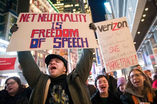 (AP Photo/Mary Altaffer, File). FILE - In this Thursday, Dec. 7, 2017 file photo, Demonstrators rally in support of net neutrality outside a Verizon store in New York. Consumers aren't likely to see immediate changes following Monday, June 11, 2018 for...