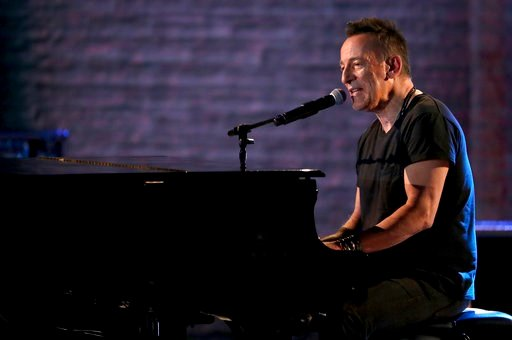 (Photo by Michael Zorn/Invision/AP). Bruce Springsteen performs at the 72nd annual Tony Awards at Radio City Music Hall on Sunday, June 10, 2018, in New York.