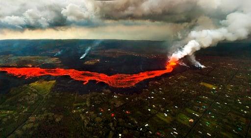 (AP Photo/L.E. Baskow). Lava from the Kilauea volcano flows in and around Pahoa, Hawaii, Sunday, June 10, 2018.