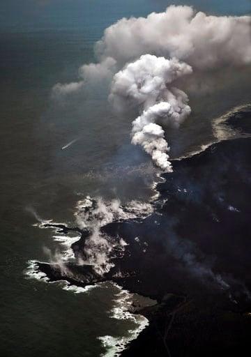 (AP Photo/L.E. Baskow). The Kapoho coastline shows steam as hot lava from the Kilauea volcano hist the surf Sunday, June 10, 2018, in Pahoa, Hawaii.