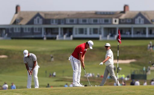 (AP Photo/Julie Jacobson). From left, Si Woo Kim, Sungjae Im and Sung Joon Park, all of South Korea, practice putting on the seventh green during a practice round for the U.S. Open Golf Championship, Monday, June 11, 2018, in Southampton, N.Y.