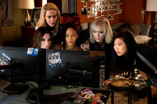 "(Barry Wetcher/Warner Bros. via AP). This image released by Warner Bros. shows, from foreground left, Sandra Bullock Sarah Paulson, Rihanna, Cate Blanchett and Awkwafina in a scene from ""Ocean's 8."""