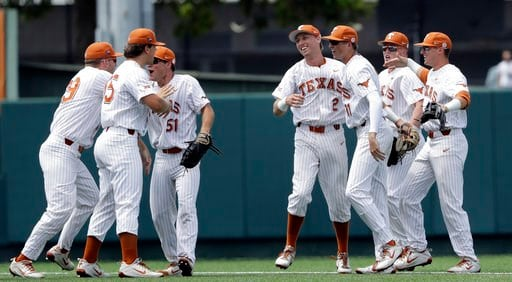 (AP Photo/Eric Gay). Texas' Kody Clemens (2) and Duke Ellis (11) celebrate with teammates following their win over Tennessee Tech in an NCAA college super regional baseball game, Monday, June 11, 2018, in Austin, Texas. Texas won 5-2.