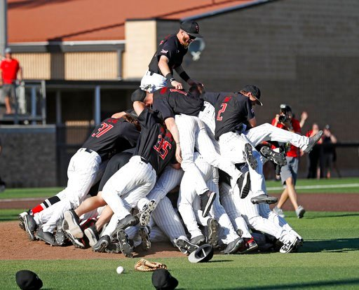 (Brad Tollefson/Lubbock Avalanche-Journal via AP). Texas Tech players celebrate after an NCAA college baseball tournament super regional game against Duke, Monday, June 11, 2018, in Lubbock, Texas.