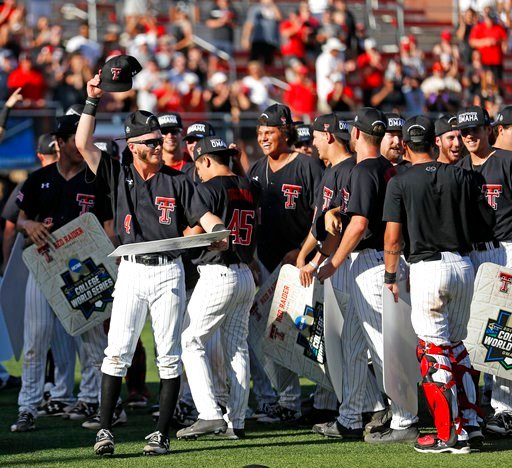 (Brad Tollefson/Lubbock Avalanche-Journal via AP). Texas Tech's Grant Little (4) celebrates with his teammates after an NCAA college baseball tournament super regional game against Duke, Monday, June 11, 2018, in Lubbock, Texas.