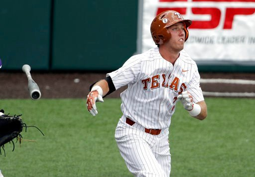 (AP Photo/Eric Gay). Texas' Kody Clemens (2) reacts as he flies out in the fifth inning of an NCAA college super regional baseball game against Tennessee Tech, Monday, June 11, 2018, in Austin, Texas.