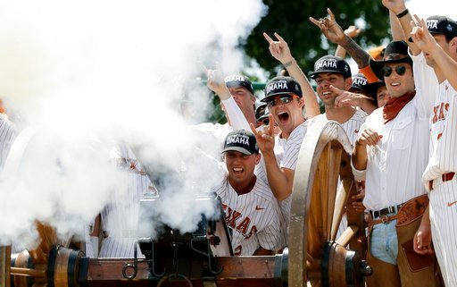 (AP Photo/Eric Gay). Texas' Kody Clemens (2) and his teammates fire the school cannon as they celebrate their win over Tennessee Tech in an NCAA college super regional baseball game, Monday, June 11, 2018, in Austin, Texas. Texas won 5-2.