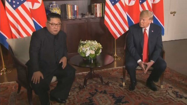 President Trump and North Korea dictator Kim Jong Un sit together side by side in historic summit. (Source: CNN)