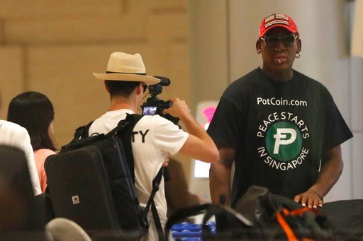 (AP Photo/Wong Maye-E). Former NBA basketball player Dennis Rodman arrives at Singapore's Changi Airport on Tuesday, June 12, 2018.