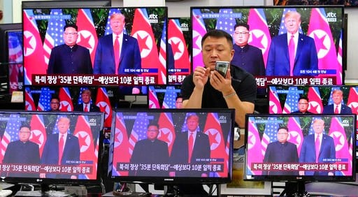 (AP Photo/Ahn Young-joon). TV screens shows U.S. President Donald Trump, right, meets with North Korean leader Kim Jong Un in Singapore, during a news program at Yongsan Electronic store in Seoul, South Korea, South Korea, Tuesday, June 12, 2018.