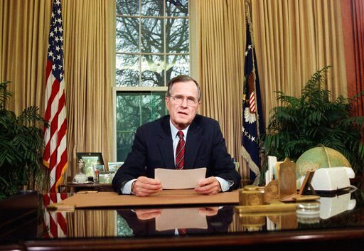 (AP Photo/Barry Thumma, File). In this Dec. 20, 1989, file photo, President George H.W. Bush addresses the nation on television from the Oval Office in Washington as he explains his decision to deploy American troops to Panama.