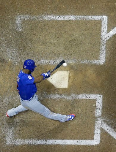 (AP Photo/Morry Gash). Chicago Cubs' Jason Heyward hits an RBI single during the eighth inning of a baseball game against the Milwaukee Brewers Monday, June 11, 2018, in Milwaukee.