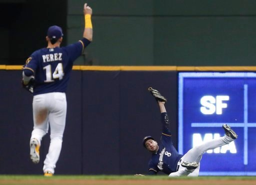 (AP Photo/Morry Gash). Milwaukee Brewers' Ryan Braun makes a diving catch on a ball hit by Chicago Cubs' Anthony Rizzo during the fourth inning of a baseball game Monday, June 11, 2018, in Milwaukee.
