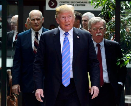 (Sean Kilpatrick/The Canadian Press via AP). U.S. President Donald Trump leaves the G7 Leaders Summit in La Malbaie, Que., on Saturday, June 9, 2018., with White House Chief of Staff John Kelly, left, and National Security Adviser John Bolton.