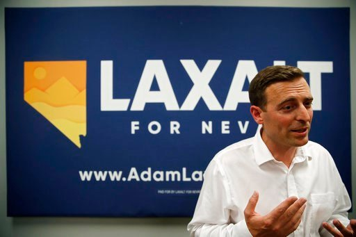 (AP Photo/John Locher). Nevada state Attorney General Adam Laxalt speaks with members of the media at a campaign event Monday, June 11, 2018, in Las Vegas.