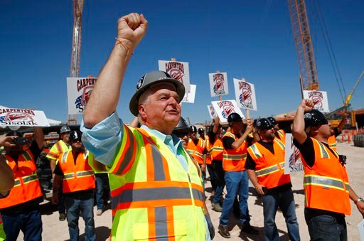 (AP Photo/John Locher). Clark County Commission member and Democratic gubernatorial candidate Steve Sisolak chants with supporters while touring the site of the future Raiders football stadium Monday, June 11, 2018, in Las Vegas.