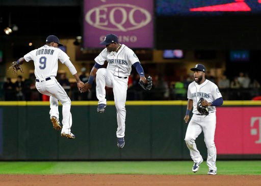 (AP Photo/Ted S. Warren). Seattle Mariners second baseman Dee Gordon, left, celebrates with center fielder Guillermo Heredia, center, after the Mariners beat the Los Angeles Angels 5-3 in a baseball game, Monday, June 11, 2018, in Seattle.