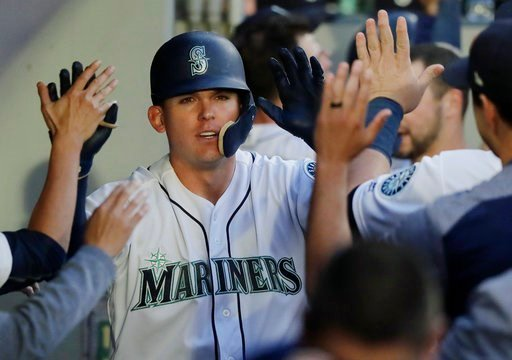 (AP Photo/Ted S. Warren). Seattle Mariners' Ryon Healy is greeted in the dugout after he hit a two-run home run during the fourth inning of a baseball game against the Los Angeles Angels, Monday, June 11, 2018, in Seattle.