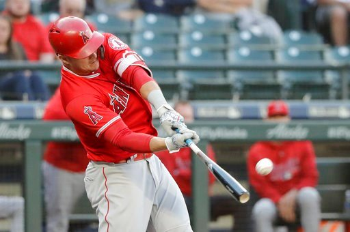 (AP Photo/Ted S. Warren). Los Angeles Angels' Mike Trout hits a solo home run against the Seattle Mariners during the first inning of a baseball game, Monday, June 11, 2018, in Seattle.