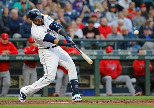 (AP Photo/Ted S. Warren). Seattle Mariners' Nelson Cruz hits a solo home run during the fourth inning of a baseball game against the Los Angeles Angels, Monday, June 11, 2018, in Seattle. It was his second of the game.