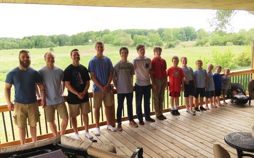 (AP Photo/Mike Householder). In a photo from May 30, 2018, the 14 brothers of the Schwandt family pose for a photo at their farm in Lakeview, Mich. From left are Tyler, Zach, Drew, Brandon, Tommy, Vinny, Calvin, Gabe, Wesley, Charlie, Luke, Tucker, Fra...