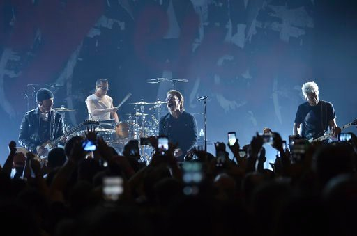 The Edge, left, Larry Mullen Jr., Bono and Adam Clayton of U2 perform during a concert at the Apollo Theater hosted by SiriusXM on Monday, June 11, 2018, in New York. (Photo by Evan Agostini/Invision/AP