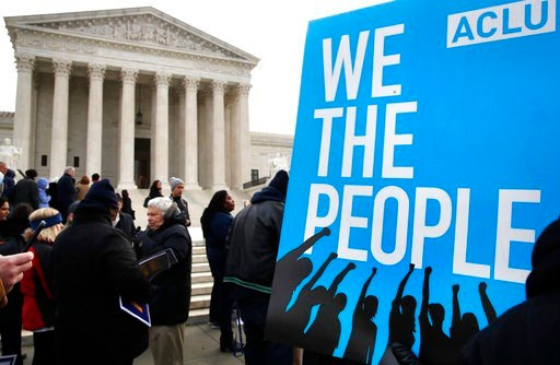 (AP Photo/Jacquelyn Martin, File). In this Jan. 10, 2018, file photo, people rally outside of the Supreme Court in opposition to Ohio's voter roll purges in Washington.