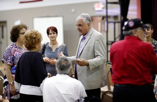 (AP Photo/John Locher, File). FILE - In this May 8, 2018, file photo, Clark County Commission member Steve Sisolak meets with people during a forum for Nevada gubernatorial candidates organized by Nevada faith groups. The fiercest primary election batt...