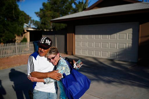 (AP Photo/John Locher). In this June 6, 2018, photo, Clark County Commission member Chris Giunchigliani, right, hugs Anthony Gonzalez while campaigning in Las Vegas. The fiercest primary election battle in Nevada this year is a race between two Democra...