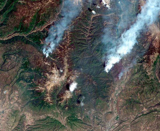 (Satellite image ©2018 DigitalGlobe, a Maxar company via AP). This June 9, 2018, satellite image provide by DigitalGlobe shows the 416 Fire, right, and the Burro Fire, left, northwest of Durango, Colo.