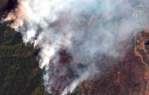 (Satellite image ©2018 DigitalGlobe, a Maxar company via AP). This June 10, 2018, satellite image provide by DigitalGlobe shows the 416 Fire northwest of Hermosa, Colo. At right Highway 550 is visible.