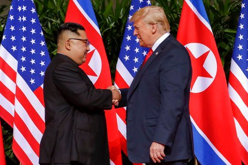 (AP Photo/Evan Vucci). U.S. President Donald Trump shakes hands with North Korea leader Kim Jong Un at the Capella resort on Sentosa Island Tuesday, June 12, 2018 in Singapore.