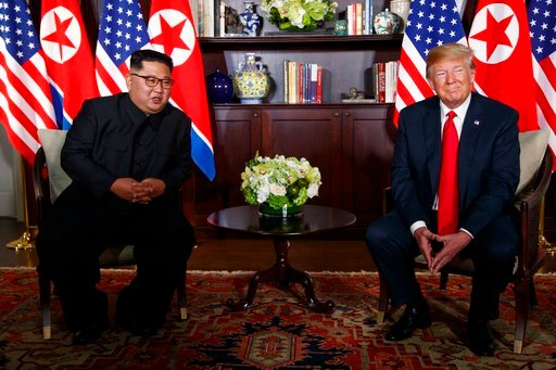 (AP Photo/Evan Vucci). President Donald Trump meets with North Korean leader Kim Jong Un on Sentosa Island, Tuesday, June 12, 2018, in Singapore.