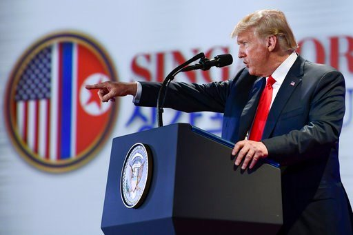 (AP Photo/Susan Walsh). U.S. President Donald Trump answers questions about the summit with North Korea leader Kim Jong Un during a press conference at the Capella resort on Sentosa Island Tuesday, June 12, 2018 in Singapore.