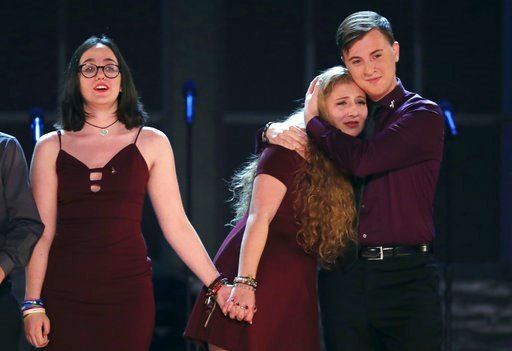 """(Photo by Michael Zorn/Invision/AP). Students from the Marjory Stoneman Douglas High School drama department react after performing """"Seasons of Love"""" at the 72nd annual Tony Awards at Radio City Music Hall on Sunday, June 10, 2018, in New York."""