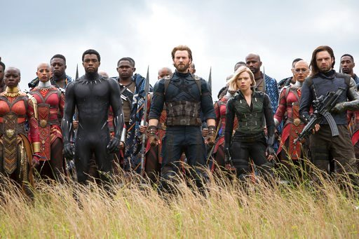 """(Chuck Zlotnick/Marvel Studios via AP). This image released by Marvel Studios shows, front row from left, Danai Gurira, Chadwick Boseman, Chris Evans, Scarlet Johansson and Sebastian Stan in a scene from """"Avengers: Infinity War."""" The supersized superhe..."""