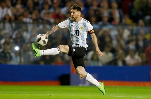 (AP Photo/Natacha Pisarenko, File). FILE - In this May 29, 2018, file photo, Argentina's Lionel Messi controls the ball during a friendly soccer match between Argentina and Haiti at the Bombonera stadium in Buenos Aires, Argentina. Lionel Messi and Cri...