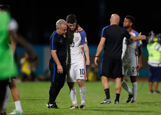 (AP Photo/Rebecca Blackwell, File). FILE - In this Oct. 10, 2017, file photo, United States' Christian Pulisic, (10) is comforted after losing 2-1 against Trinidad and Tobago during a 2018 World Cup qualifying soccer match in Couva, Trinidad. The Unite...