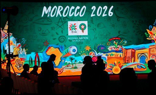 (AP Photo/Abdeljalil Bounhar, file). FILE - In this Saturday March 17, 2018 file photo, a giant screen displays the logo of Morocco 2026 before a press conference to promote Morocco's bib for the 2026 soccer World Cup in Casablanca, Morocco. The 2026 W...