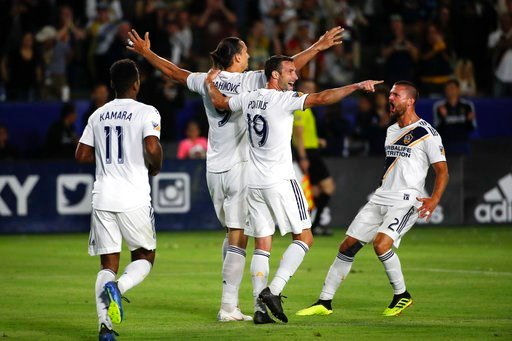 (AP Photo/Jae C. Hong). LA Galaxy's Zlatan Ibrahimovic, center left, of Sweden, celebrates his goal with Chris Pontius, center right, Perry Kitchen, right, and Ola Kamara during the second half of an MLS soccer match against the Real Salt Lake Saturday...