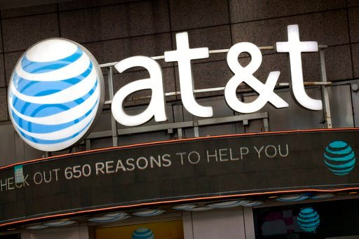 (AP Photo/Mark Lennihan, File). FILE - In this Monday, Oct. 24, 2016, file photo, the AT&T logo is positioned above one of its retail stores, in New York.  The fate of the AT&T-Time Warner merger, a massive media deal opposed by the government ...
